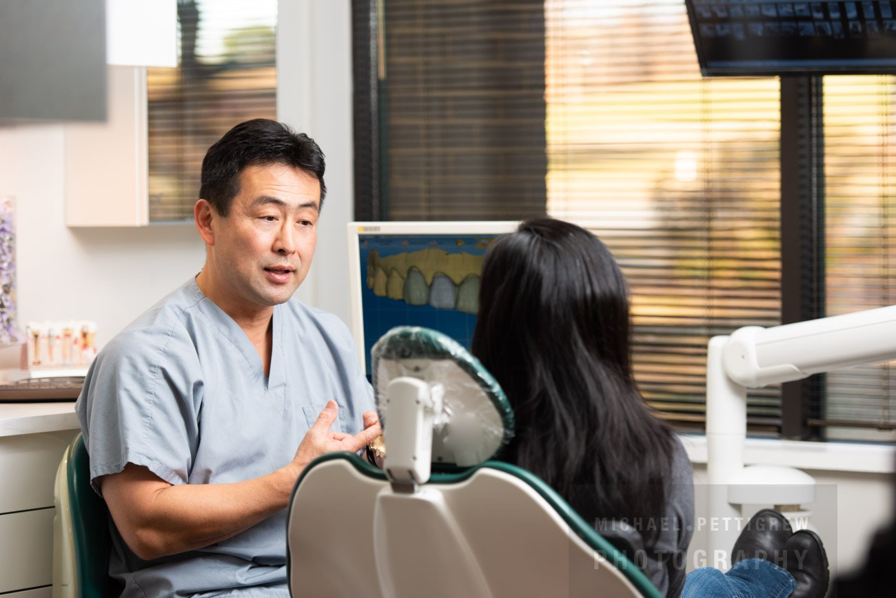 professional photography session with dentist and patient in Reston VA